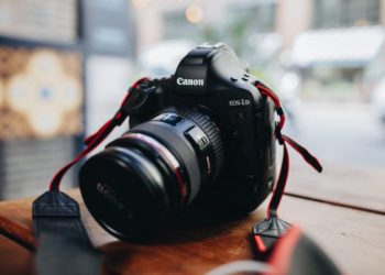 Canon-camera-with-partial-strap-showing
